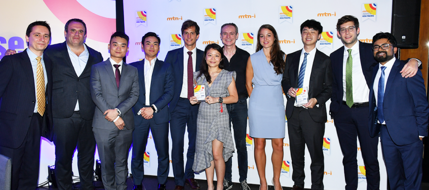 Group picture of the Crédit Agricole CIB team holding the mtn-i awards